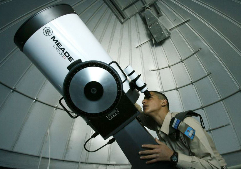 man-looking-through-telescope-4-post