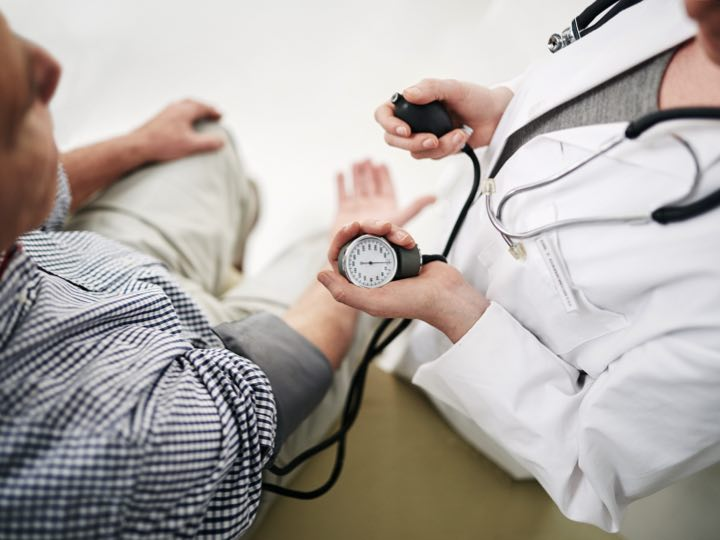 physician monitoring vital signs
