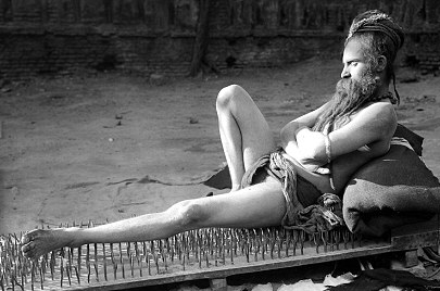 man on bed of nails